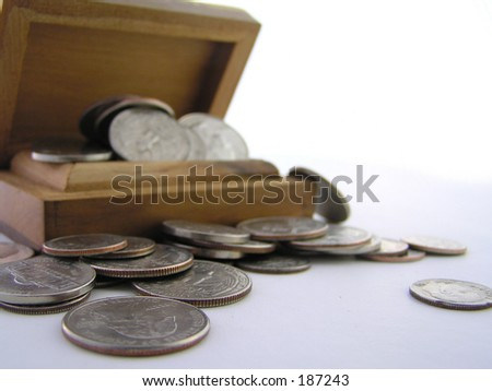 a macro of coins in a box suggesting savings or wealth