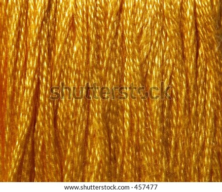 A macro of yellow embroidery thread. - stock photo