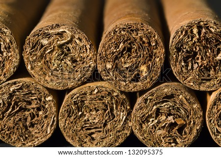 A macro photo of a bundle of cigars.