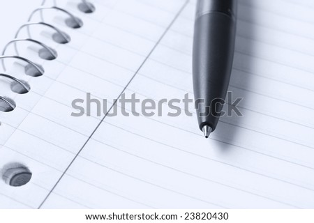 a macro picture of a pen and notebook - stock photo