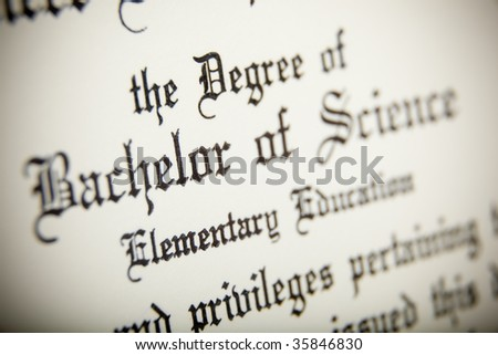 A macro shot of a Bachelor or Science Degree, very narrow depth of field - stock photo