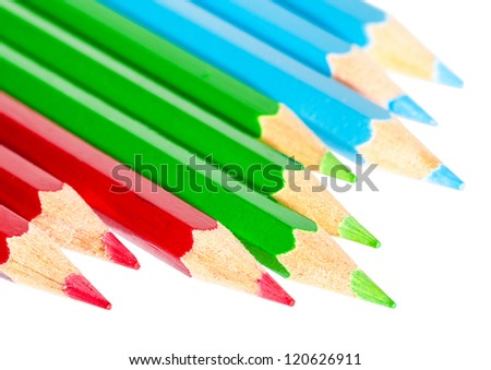 A macro shot of a collection of coloured pencils.