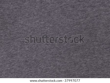 A macro shot of a gray T shirt