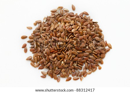 A macro shot of a heap of flaxseed - stock photo