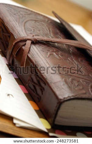 A macro shot of a luxurious leather notbook. - stock photo
