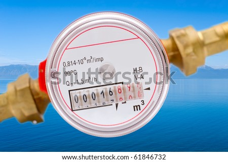 a macro shot of a water meter against Baikal - the deepest world fresh water reservoir - stock photo