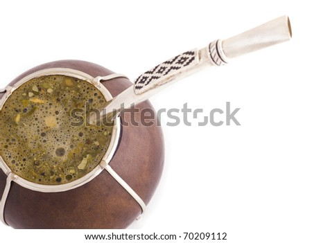 A macro shot of Argentinian mate with a bomba/bombija. - stock photo