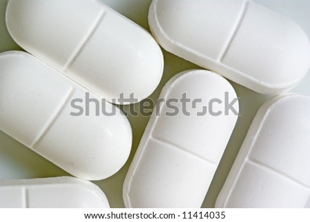 A macro shot of some pills on white