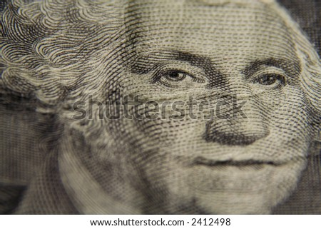 A macro shot of the face of George Washington on a one dollar bill - stock photo