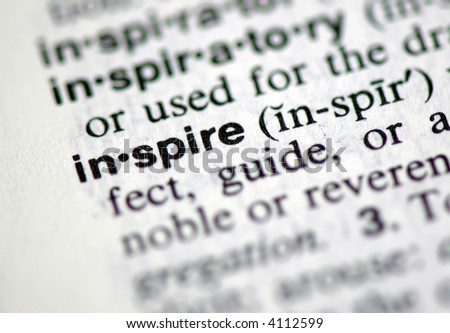 "A macro shot of the word ""Inspire"" from the dictionary - stock photo"