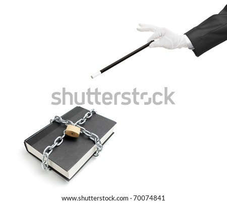 A magician holding a magic wand over a book with chain and padlock isolated on white background - stock photo