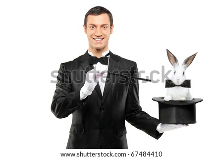 A magician in a black suit holding a top hat with a rabbit in it isolated on white background - stock photo