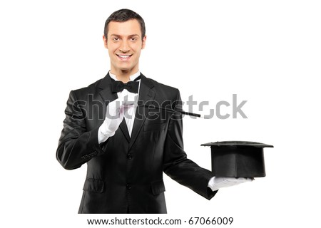 A magician in a black suit holding an empty top hat and magic wand isolated on white background