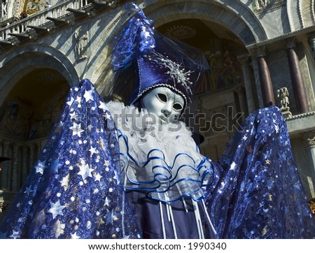 a magician wizard is dressed for the Carnivale in Venice,Italy,in St Marks square - stock photo