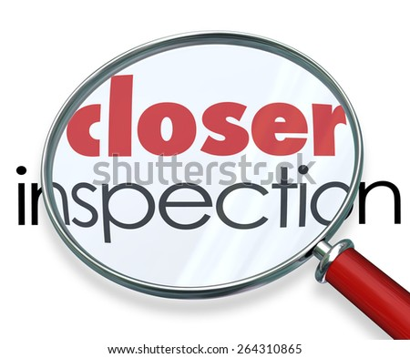 A magnifying glass hovering over several words, at the center of which is Confidence - stock photo