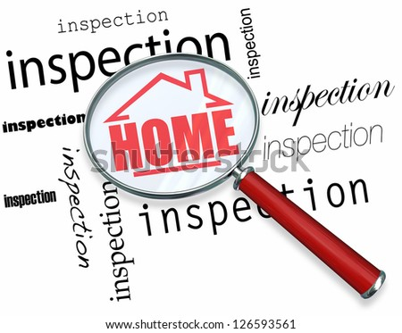 A magnifying glass hovering over the words Inspection, centering on a house with the word Home inside it - stock photo
