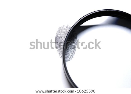 a magnifying lens over a fingerprint on white background - stock photo