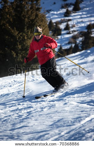 A main skiing on ski resort - stock photo