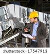 A maintenance engineer checking an industrial conveyor belt - stock photo