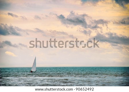 a majestic seascape with water, sky and boat