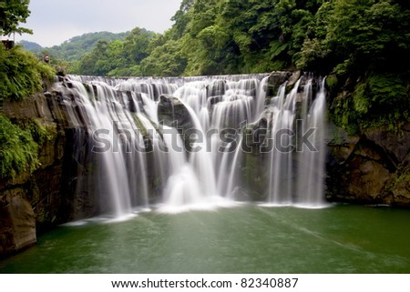 a majestically beautiful waterfall in Taiwan - stock photo