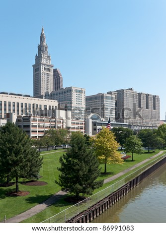 A major Cleveland, Ohio corporation's well manicured employee recreation area on the bank of the Cuyahoga River with the Terminal Tower and a portion of the Tower City complex in the background - stock photo