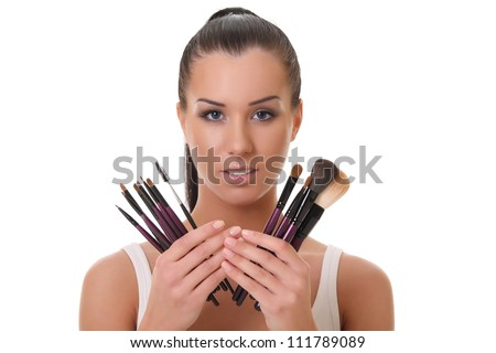 a make up artist with brushes for cosmetics - stock photo