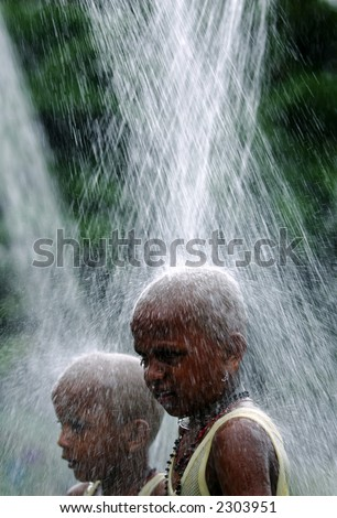 A Malaysian Hindu devotee takes a shower before performing pilgrimage to the sacred Batu Caves temple in Kuala Lumpur during Thaipusam festival, 2006. - stock photo