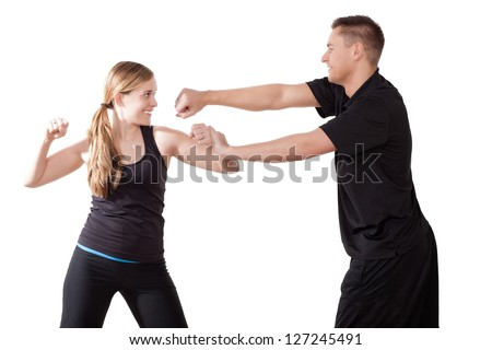 A male and female kick boxer training together throwing and blocking punches, upper body portrait isolated on white - stock photo