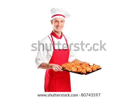 A male baker holding freshly baked croissants isolated on white background - stock photo