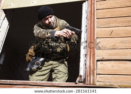 A male combatant before he opened fire - stock photo