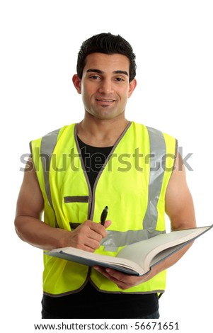 A male construction worker or other laborer holding a book and pen.  He is looking up and smiling.  White background.