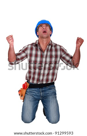 A male construction worker shouting. - stock photo
