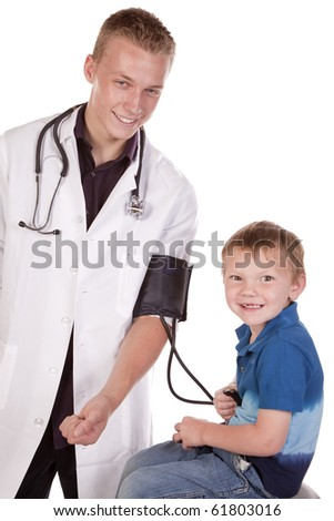 A male doctor letting his young boy patient check his blood pressure. - stock photo