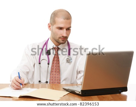 A male doctor working at the desk, isolated on white