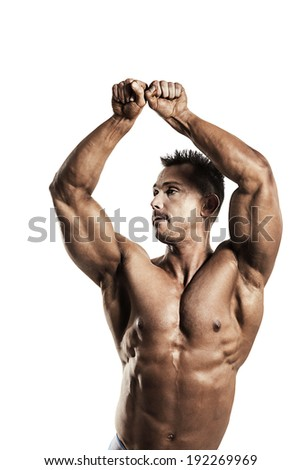 A male fit athlete posing his ripped body - stock photo