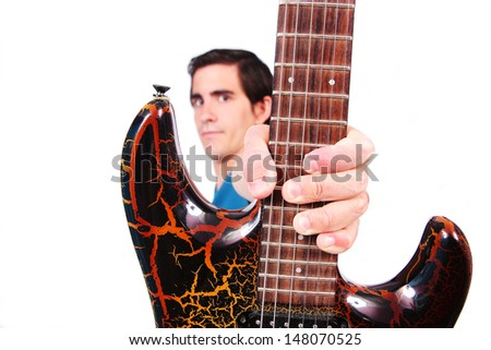 A male guitarist in action holding his electric guitar in white background - stock photo