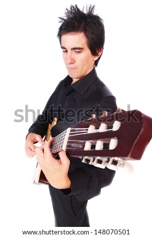 A male guitarist in action in white background - stock photo