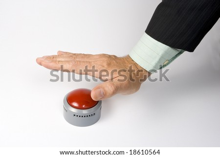 A male hand actuating a panic button. - stock photo