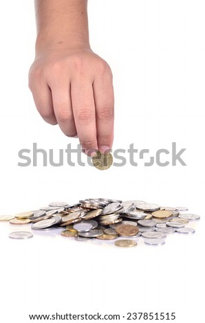 A male hand dropping coin isolated against a white background - stock photo