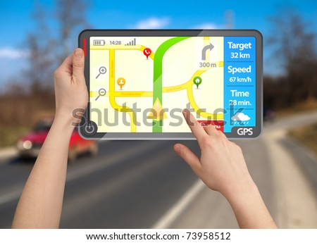 a male hand holding a modern colorful touchpad gps tablet - stock photo