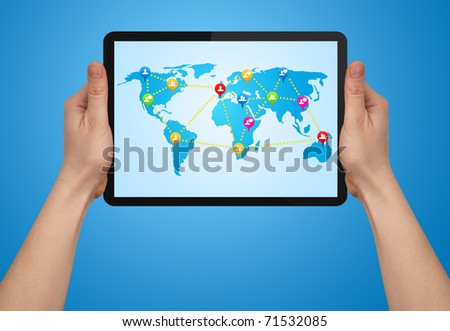 a male hand holding a modern  touchpad with social map - stock photo
