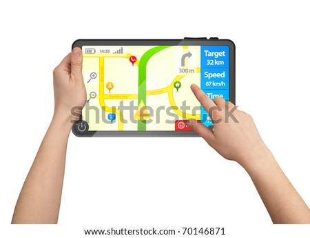 a male hand holding a touchpad gps, one finger touches the screen - stock photo
