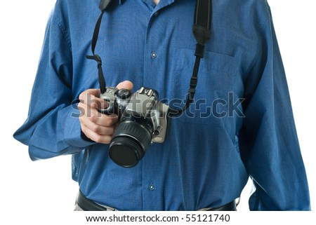 A male mid-section, wearing a blue dress shirt, holding onto an SLR camera. - stock photo
