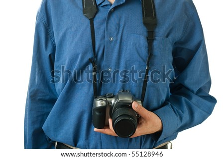 A male mid-section, wearing a blue dress shirt, holding onto an SLR camera.