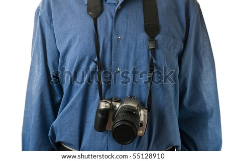 A male mid-section, wearing a blue dress shirt, with an SLR camera hanging. - stock photo