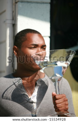 a male models relaxes with a Giant Martini after a hard day of modeling