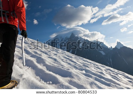 A male mountaineer walking uphill on a glacier. Mont Blanc, France. - stock photo