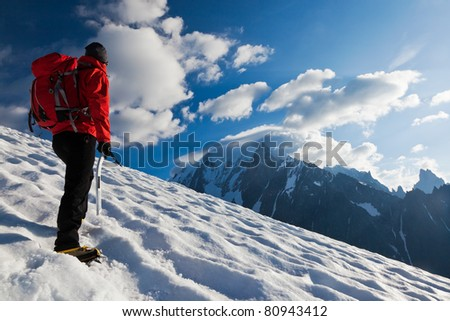 A male mountaineer walking uphill on a glacier. Mont Blanc, France.