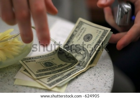 A male paying the bill at a restaurant.